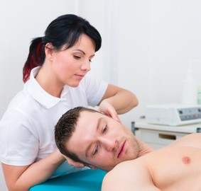 Physiotherapist set patient in practice